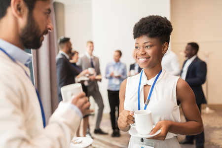 african business: business people with conference badges and coffee