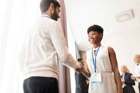 african business: handshake of people at business conference