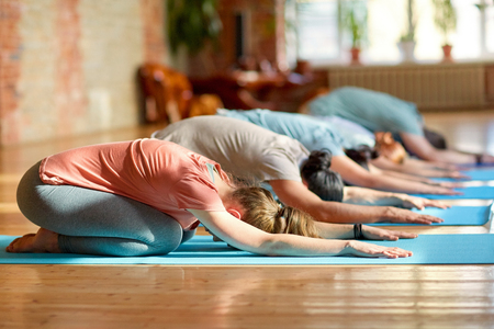 group of people doing yoga exercises at studio Stock Photo - 87689558