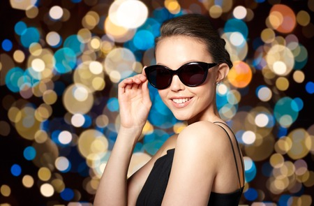 beautiful young woman in elegant black sunglasses Stock Photo