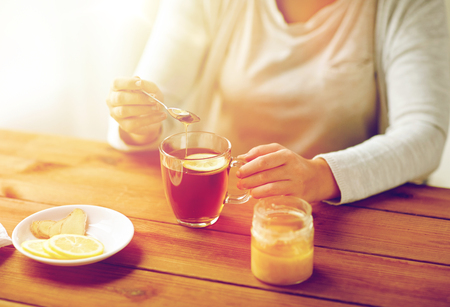 indigenous medicine: close up of ill woman drinking tea with lemon Stock Photo