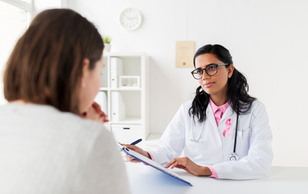 doctor with pink awareness ribbon and patient Stock Photo