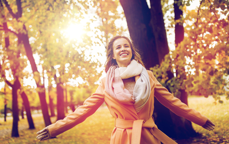 beautiful happy young woman walking in autumn park Reklamní fotografie