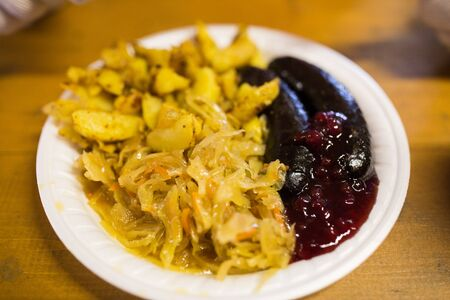 braised cabbage and sausages with sauce on plate