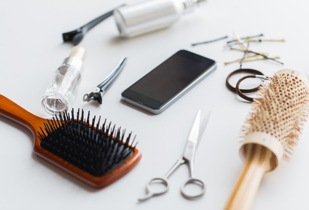 smartphone, scissors, brushes and other hair tools