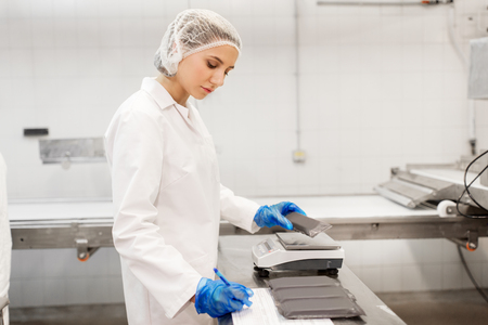 woman working at ice cream factory Stockfoto