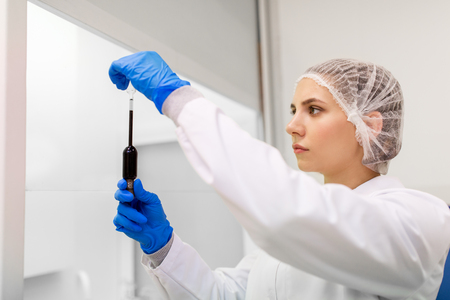 woman with sulphuric acid in dropper at laboratory Stock Photo