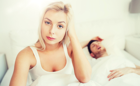 awake woman having insomnia in bed