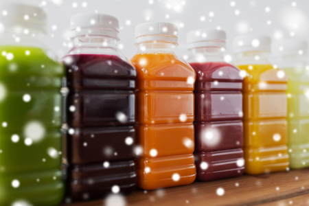 bottles with different fruit or vegetable juices