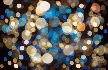 ボケ味のライトとクリスマスの背景 写真素材