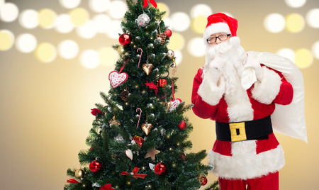santa claus with bag and christmas tree