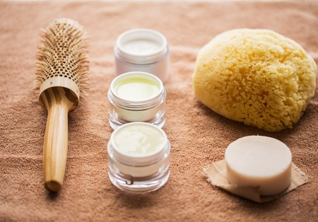 hair brush, cream, sponge, soap bar and bath towel Stock Photo