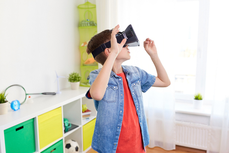 boy in virtual reality headset or 3d glasses