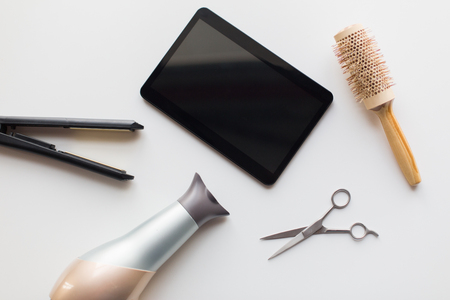 tablet pc, scissors, hairdryer, hot iron and brush