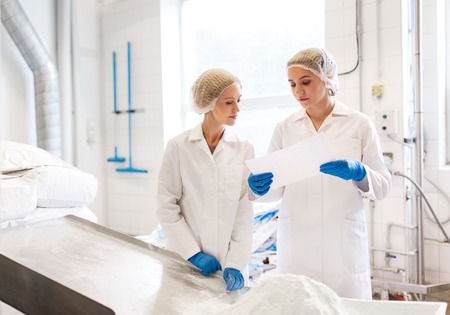 women technologists working at ice cream factory Imagens