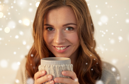 close up of woman with tea or coffee cup at home Stock Photo