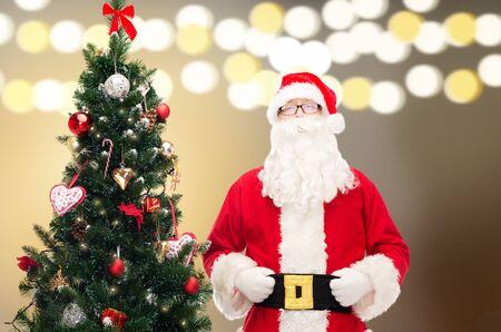 saint nicolas: santa claus at christmas tree
