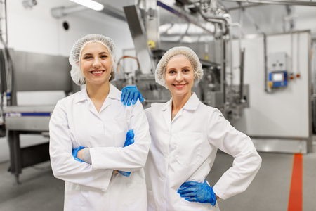 happy women technologists at ice cream factory 스톡 콘텐츠