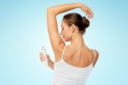 woman with antiperspirant deodorant over white Stock Photo
