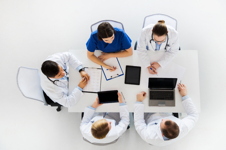doctors with cardiogram and computers at hospital Reklamní fotografie