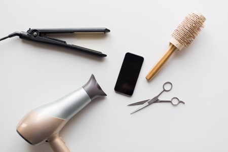smartphone, scissors, hairdryer, iron and brush