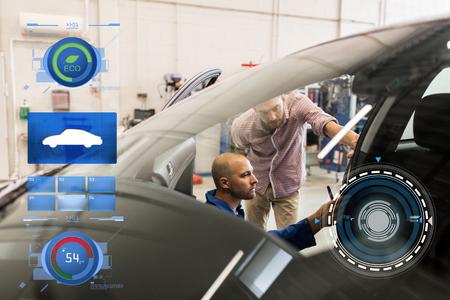 mechanic and man checking seat belt at car shop