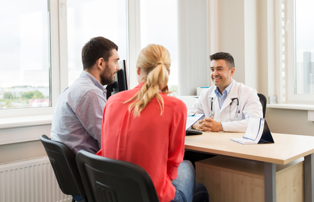 couple visiting doctor at family planning clinic Stockfoto