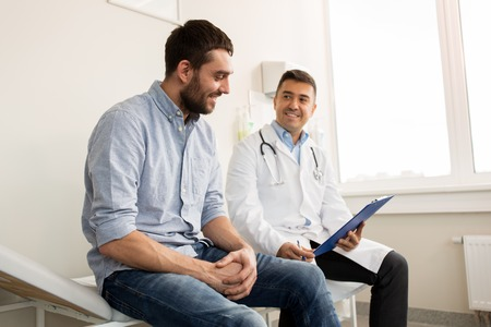 smiling doctor and young man meeting at hospital Stock Photo - 88487597