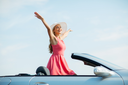 happy young woman in convertible car