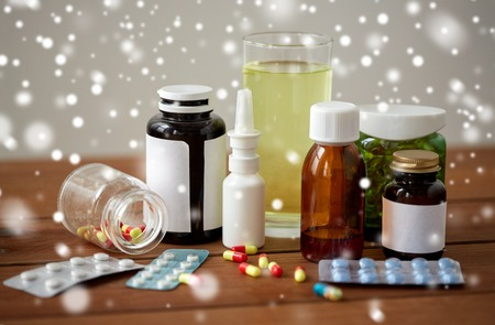 medicine and drugs on wooden table