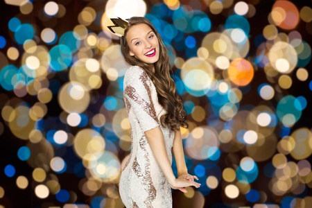 happy young woman in crown over festive lights 版權商用圖片
