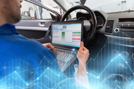 mechanic man with laptop making car diagnostic Stock Photo