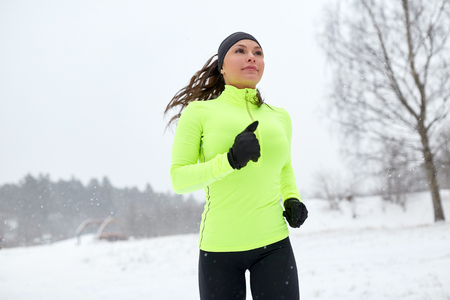 happy woman running outdoors in winter