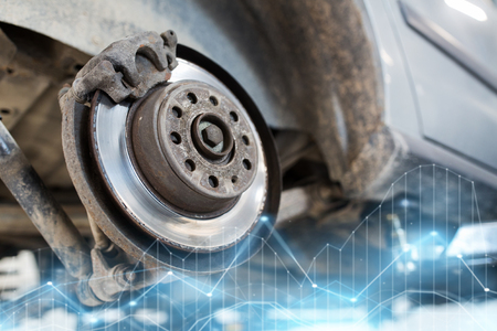 to maintain: car brake disc at repair station