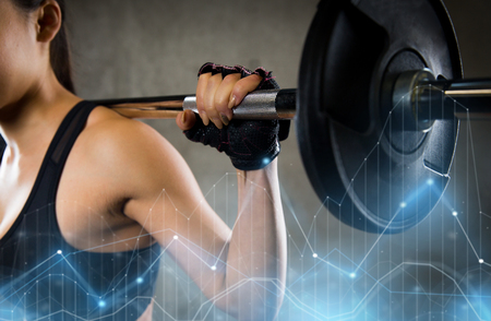 close up of woman with barbell in gym Stock Photo
