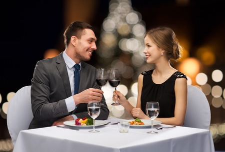 couple with non alcoholic wine at christmas Stockfoto