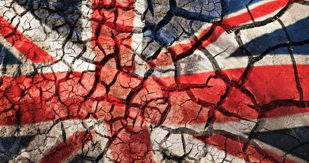 flag of great britain on cracked ground background