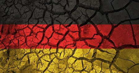german flag on cracked ground background Stock fotó