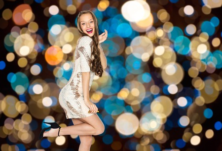 sequins: happy young woman posing over party lights