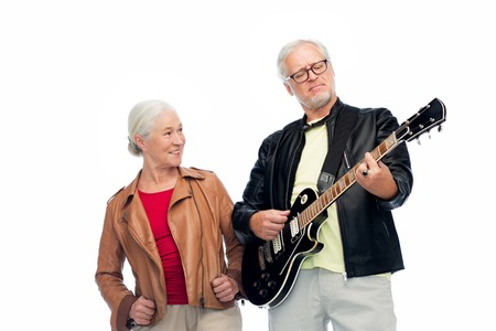 happy senior couple with electric guitar