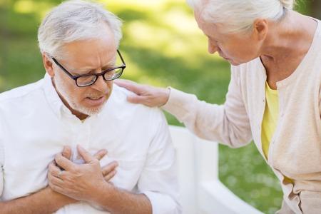 close up of senior man with heartache at park Foto de archivo