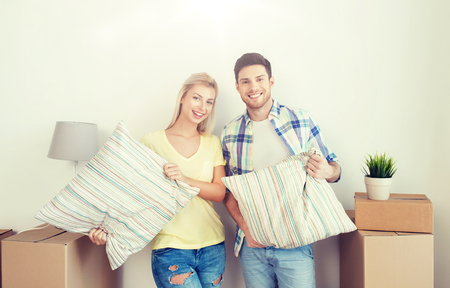 happy couple with stuff moving to new home
