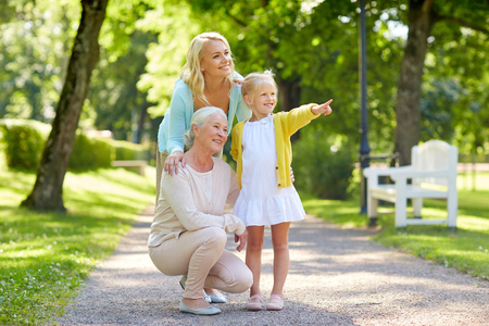 happy mother, daughter and grandmother at park