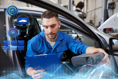 mechanic man with diagnostic scanner at car shop Stock Photo