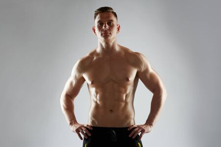 sixpack: young man or bodybuilder with bare torso