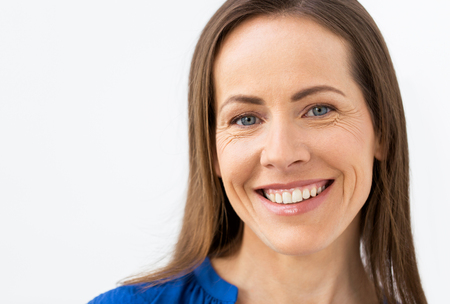 face of happy smiling middle aged woman Stockfoto