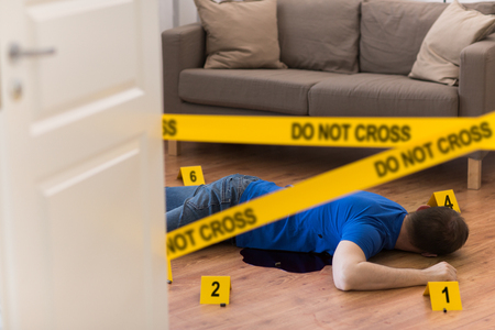 dead man body in blood on floor at crime scene
