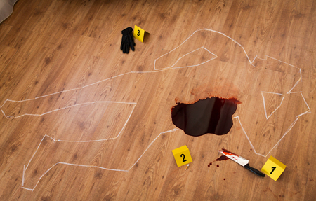 chalk outline and knife in blood at crime scene