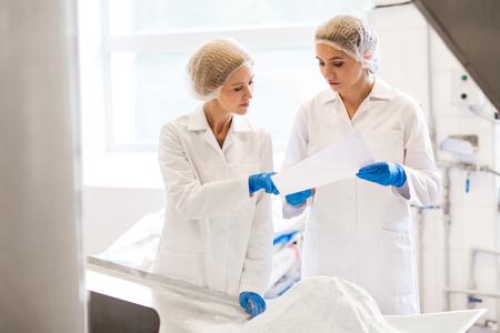 women technologists working at ice cream factory Archivio Fotografico