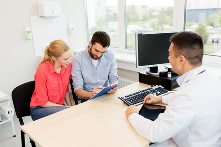 couple visiting doctor at family planning clinic Stock Photo